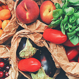 Fresh fruits and vegetables in paper bags